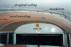 Wood paneling, insulation, and original celing